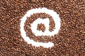 Email symbol made from coffee beans — Stock Photo