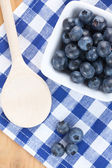 Blueberries on checkered tablecloth — Stock Photo