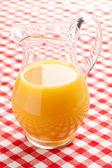 Orange juice in pitcher — Stock Photo