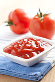 Ketchup and tomatoes — Stock Photo