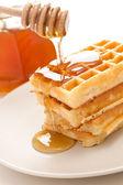 Waffle with honey — Stock Photo