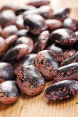 Color beans on wooden table — Stock Photo