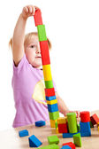 Little girl playing with toy blocks — Stock Photo