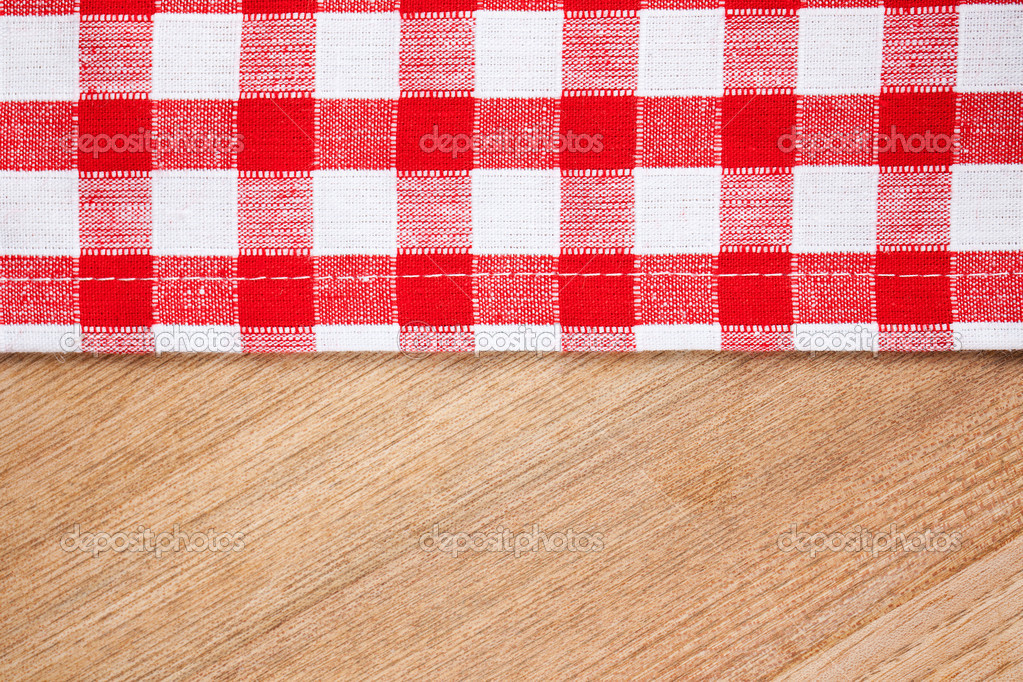 Checkered tablecloth on wooden table — Stock Photo ...