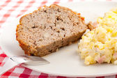 Baked meatloaf with potato salad — Stock Photo