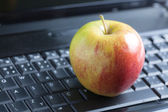 Apple on laptop — Stock Photo
