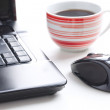 Computer mouse and coffee cup — Stock Photo #7099015
