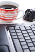 Computer mouse and coffee cup — Stock Photo