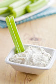 Green celery sticks with tasty dip — Stock Photo