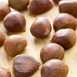 Chesnuts on wooden table — Stock Photo #7109365