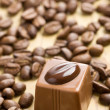 Chocolate praline and coffee beans — Stock Photo