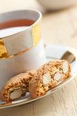 Italian cantuccini cookies with tea — Stock Photo