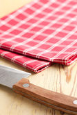 Checkered napkin and knife — Stock Photo