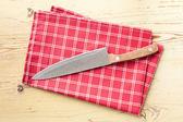 Checkered napkin and knife — Stock Photo