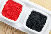 Red and black caviar in bowl — Stock Photo