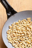 Roasted pine nuts on pan — Stock Photo