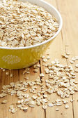 Oatmeal on wooden table — Stock Photo