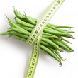 Bean pods with measuring tape — Stock Photo