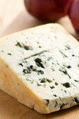Blue cheese on kitchen table — Stock Photo