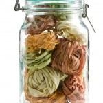 Colorful pasta tagliatelle in glass jar — Stock Photo #7145373
