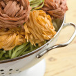 Pasta tagliatelle in colander — Stock Photo