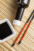 Soy sauce and chopsticks — Stock Photo