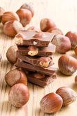 Tasty chocolate with hazelnuts — Stock Photo