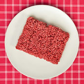 Raw minced meat on kitchen table — Stock Photo
