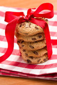 Chocolate cookies with red ribbon — Stock Photo