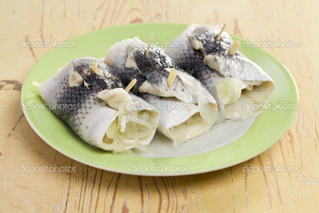 The rollmops on green plate — Stock Photo #7145025
