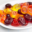 Colorful candy on plate — Stock Photo