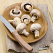 Button mushroomson kitchen table — Stock Photo #7173431