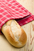 French baguette on wooden table — Stock Photo