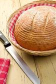 Round bread on kitchen table — Stock Photo