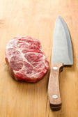 Raw juicy meat with knife — Stock Photo