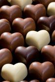 čokoládová srdíčka pozadí — Stock fotografie