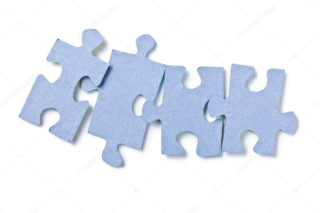 The puzzle pieces on white background — Stock Photo #7176555