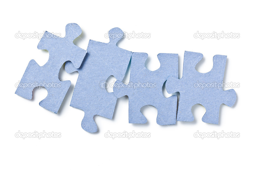 The puzzle pieces on white background — Zdjęcie stockowe #7176555