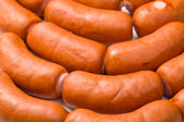 Sausages background — Stock Photo