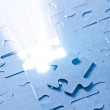 Jigsaw puzzle with white light — Stock Photo