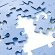 Foto Stock: Puzzle pieces on white background