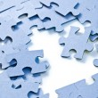 Puzzle pieces on white background — Stockfoto