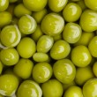 Stock Photo: Canned green peas background