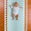 Top view of baby in cot — Stock Photo #7207057