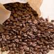 Coffee beans in paper bag — Stock Photo