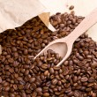 Coffee beans on wooden scoop — Foto de Stock