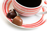 Chocolate hearts and coffee cup — Stock Photo