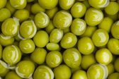 Canned green peas background — Stock Photo