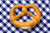 Pretzel on checkered napkin — Stok fotoğraf