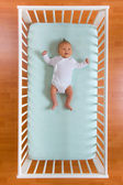 Top view of baby in cot — Stock Photo
